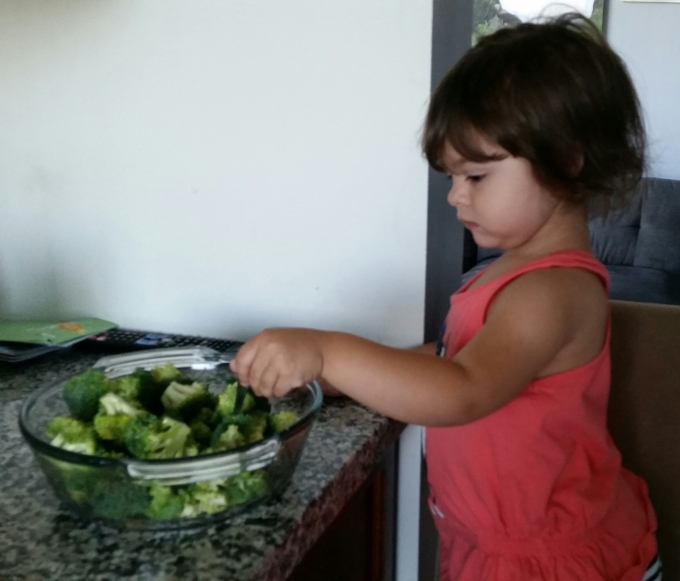Nikki helping prepare her favorite, broccoli. Yup! You read that right! ;)